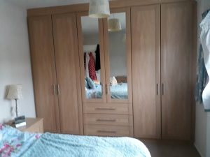 Front frame wardrobes in Montana oak finish.